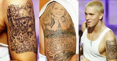 Veja a tattoo de Eminem nos braços