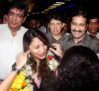 BOLLYWOOD CINEMA PHOTOS | NEWS | MORE: Madhuri Dixit and family back
