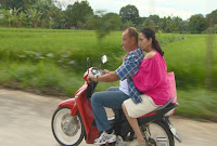 Gina Pareño and Dante Rivero on a motorcycle ride