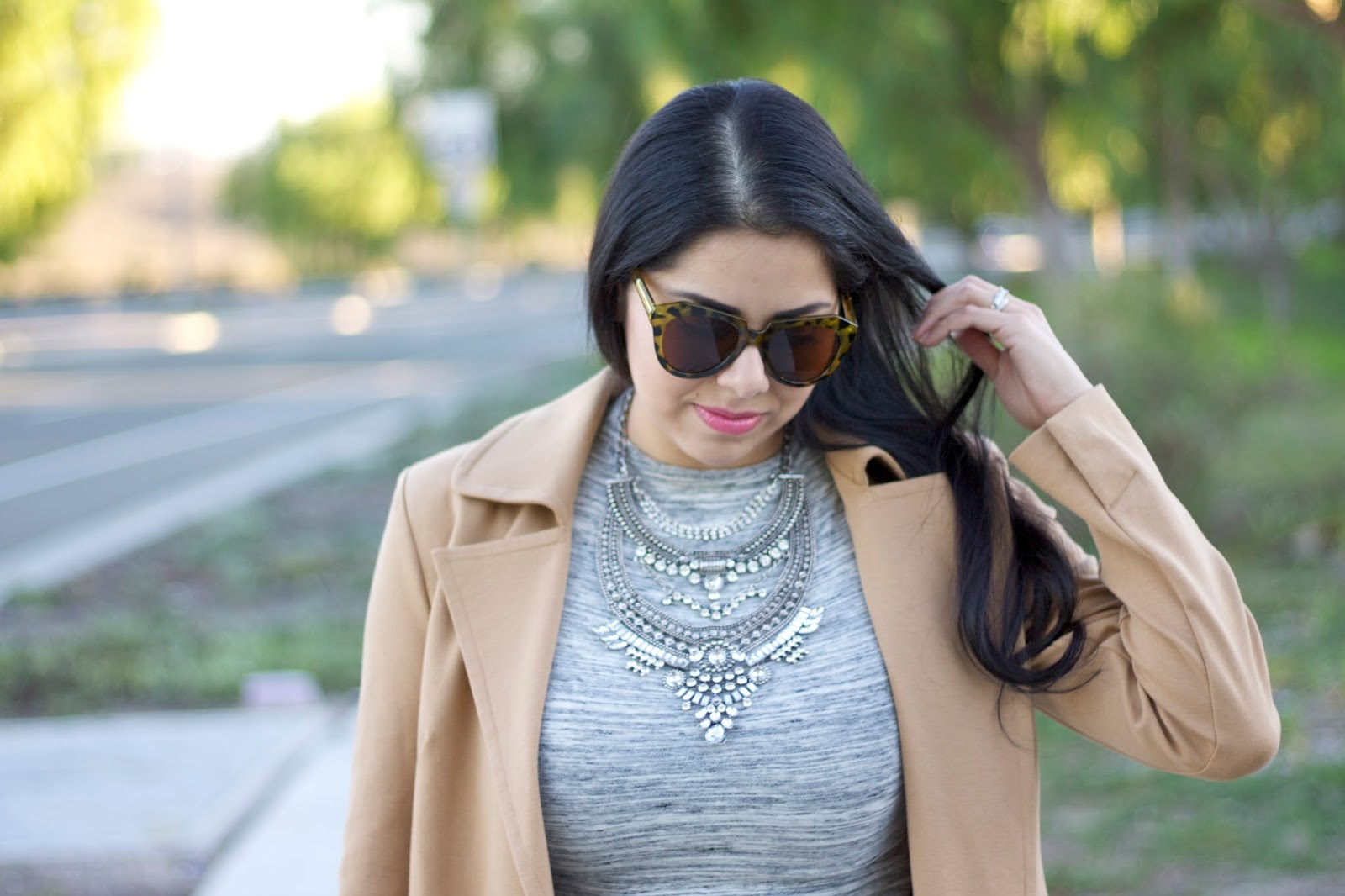 Latina fashion blogger, over the top statement necklace, grayscale midi dress, tan coat
