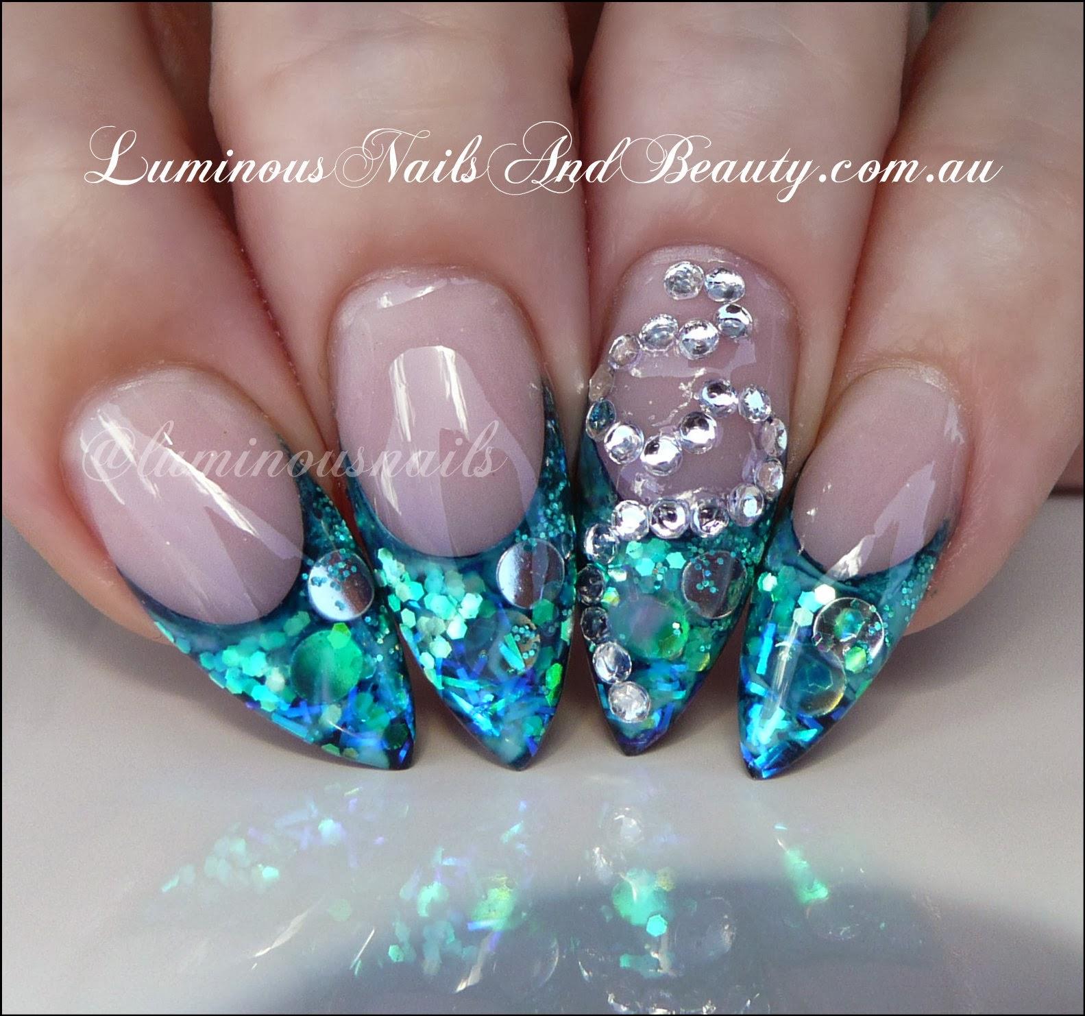 Mint green stiletto nails