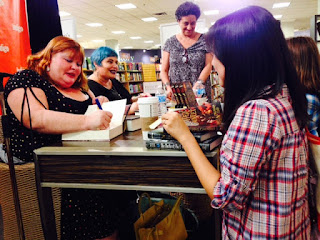Cassie's signing my books!