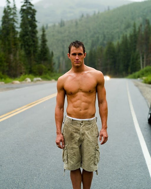 shirtless guy hitchhiking