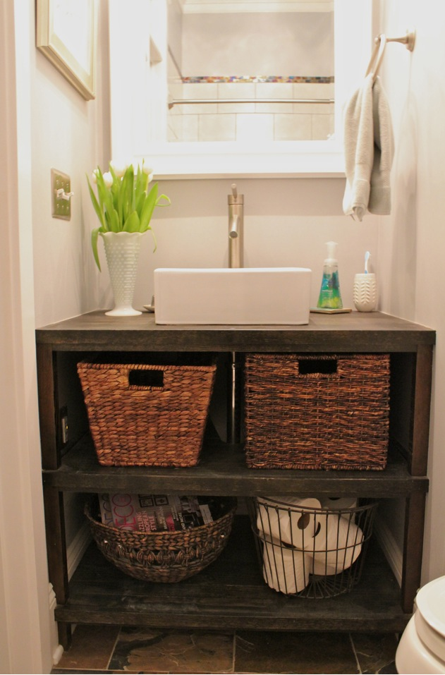 cabinet but I like the wall to wall vanity with the vessel sink