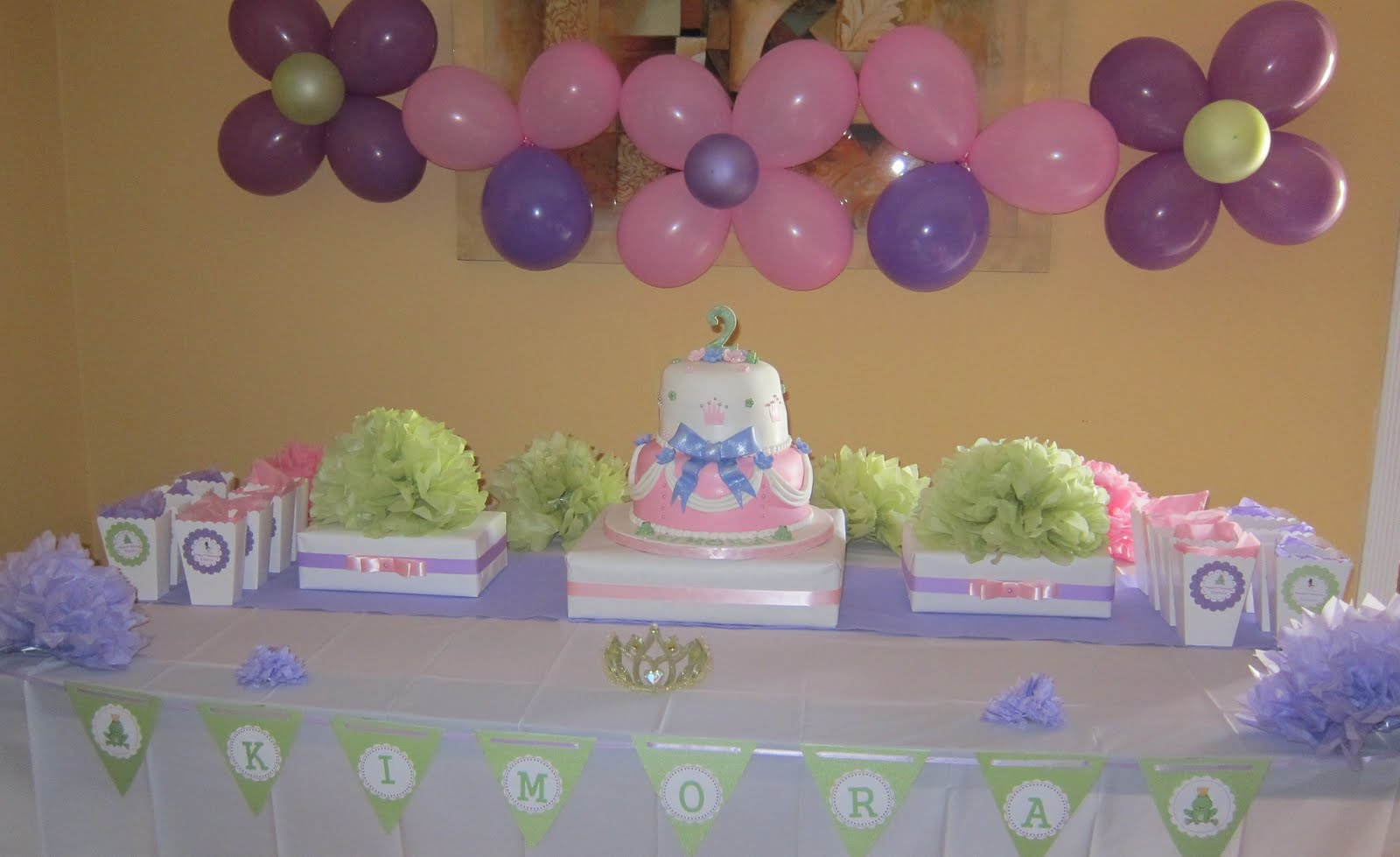 Simplyiced party details princess and the frog birthday party for Baby birthday decoration ideas