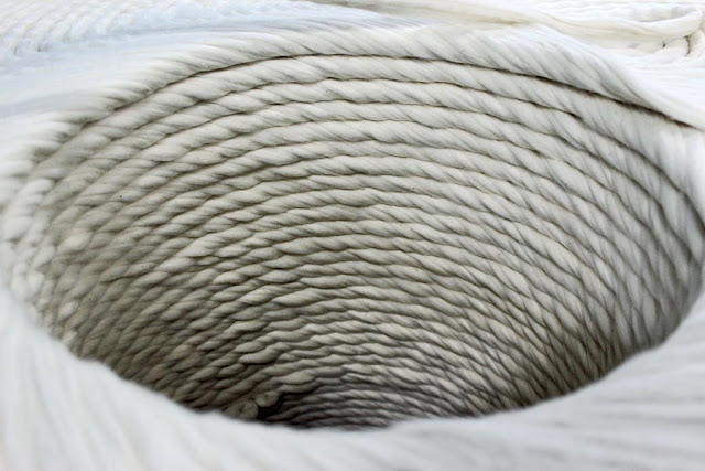 a large spool of white thread