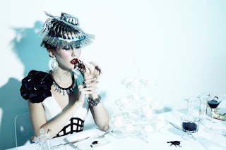 woman eating spider, haute couture, fashion photography, dinner table