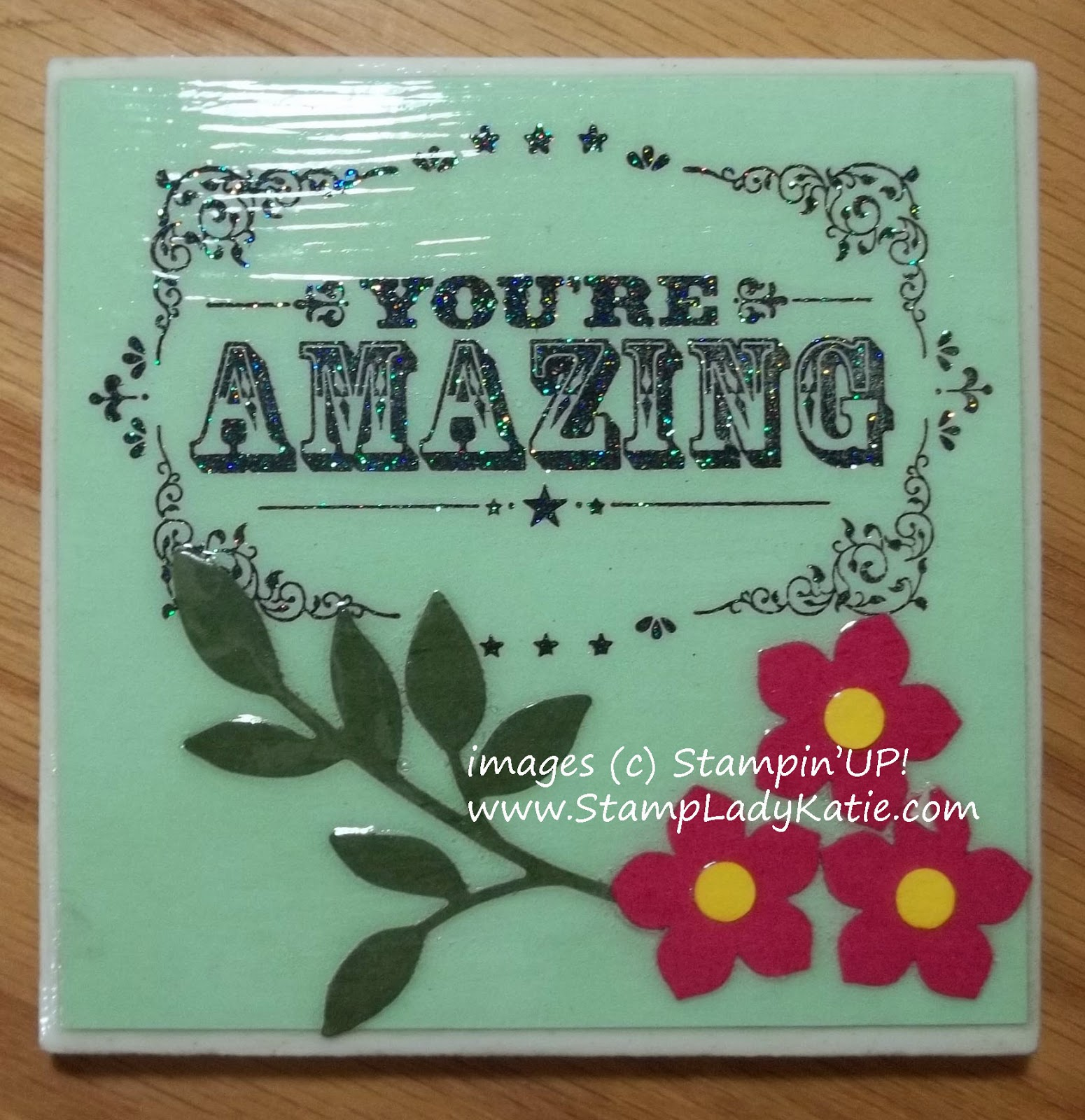 Tile Coaster with a punch art flower and Modge Podge Finish