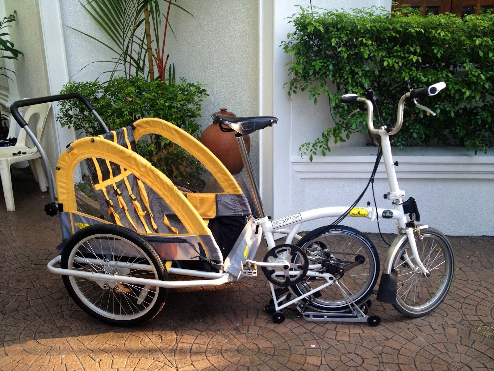 Riding A Folding Bike Around Manila Instep Rocket Bike Trailer