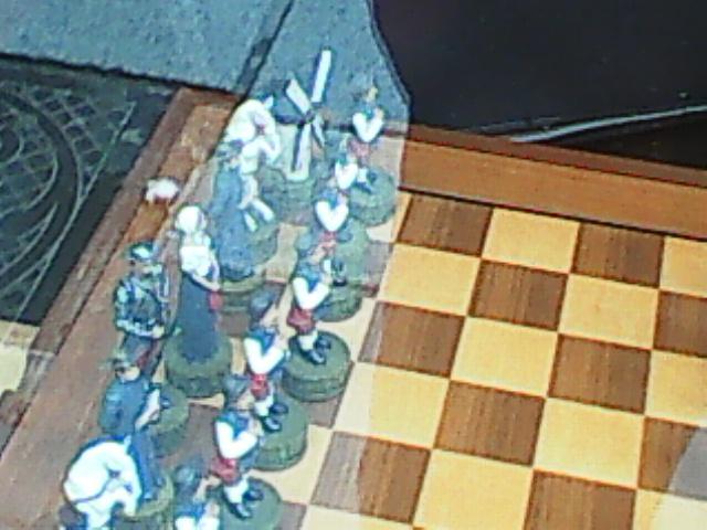 acedrez con  figures  de qujote