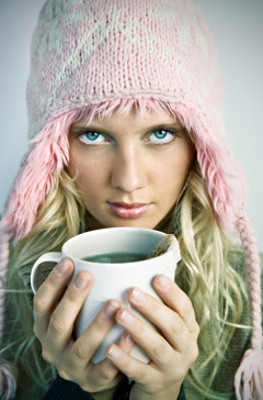 Female with Hat Holding a cup of Green Tea