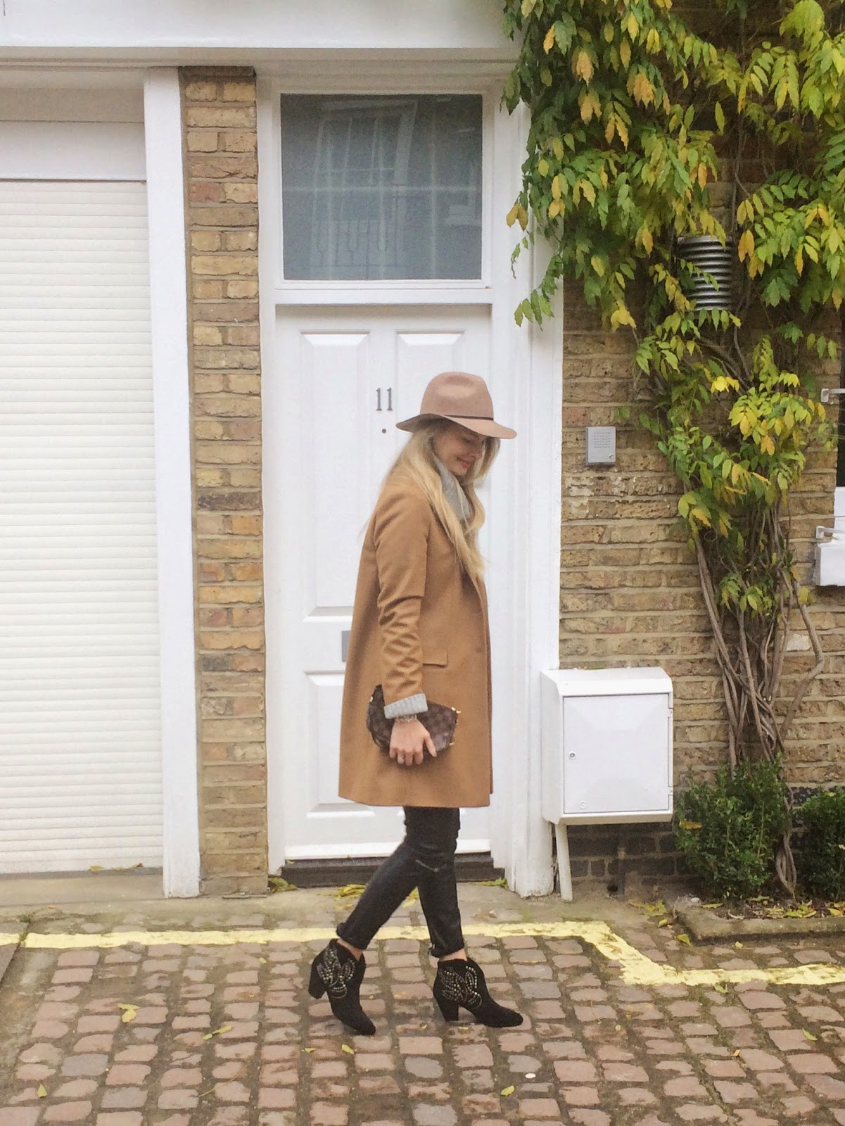 ash booties, ash shoes, leather pants, camel coat, camel hat, fedora hat, louis vuitton clutch bag, london,  street style