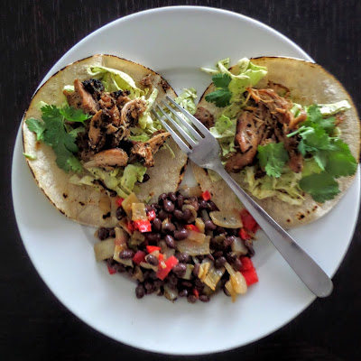 Simple Chicken Tacos and Black Beans:  A very simple dinner using leftover chicken for tacos and a quick black bean side dish.