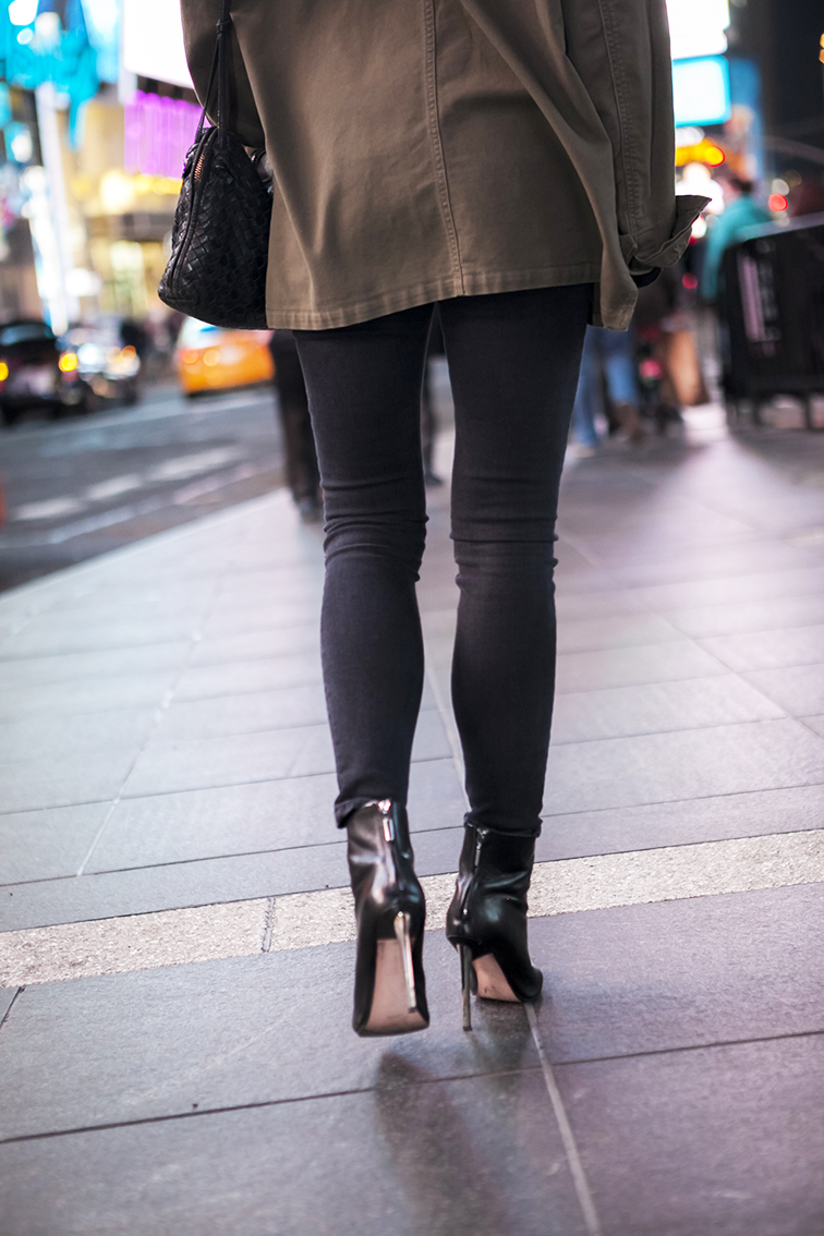 Asos black skinny jeans, leather pointy toe stiletto booties, Bottega Veneta cross body intrecciato leather bag, army jacket, on the street