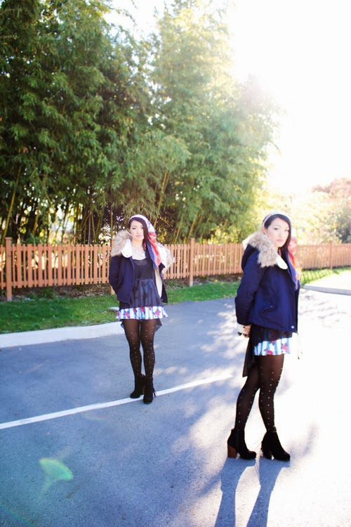 Vancouver fashion blogger jasmine zhu, sheer black top, blue floral shorts, studded tights, blue furry jacket