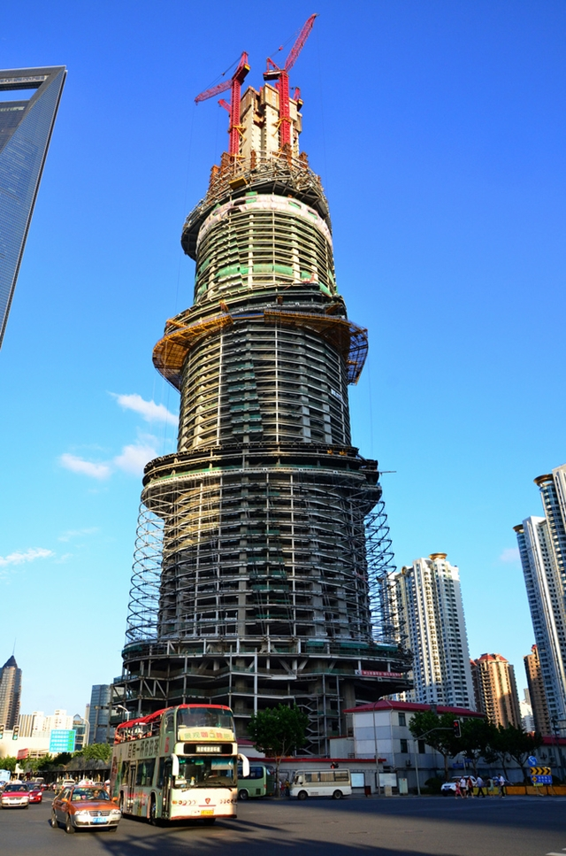 Shanghai Tower construction as seen from the street looking up