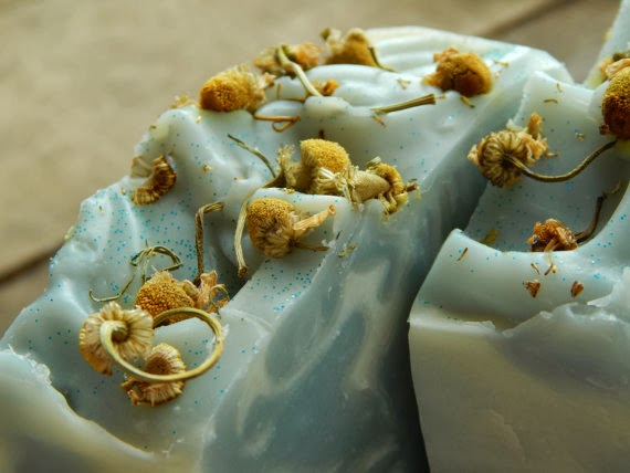Blue swirl soap with flowers on top for Color Palette Inspiration