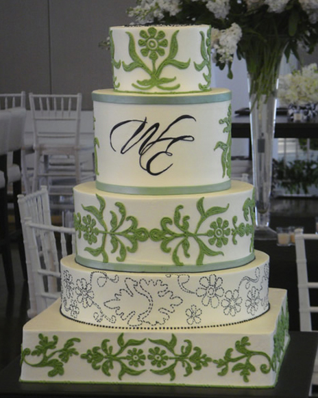 This last gorgeous green wedding cake with orange flowers created by the Jim