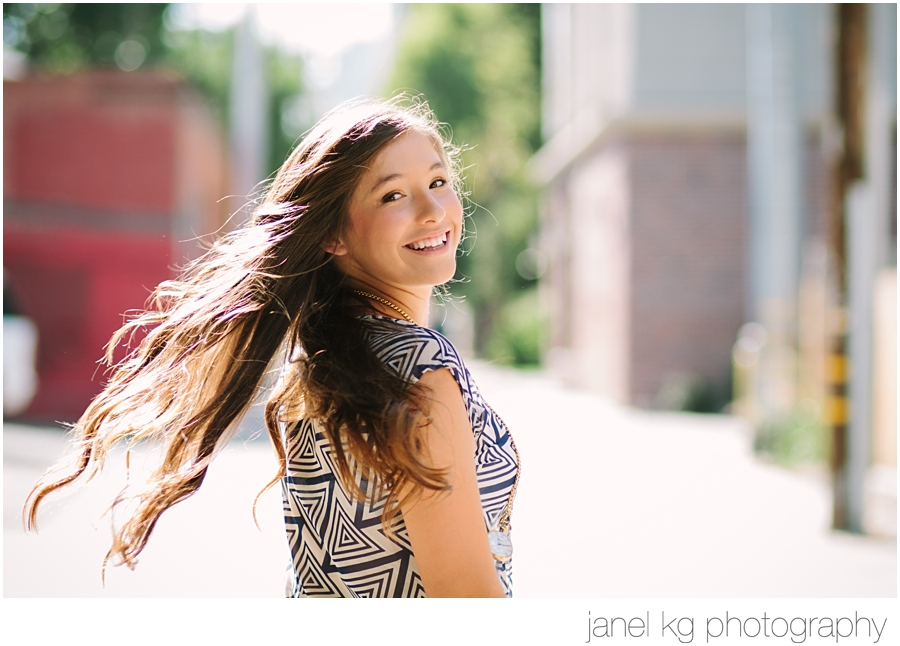 Sacramento senior portrait photographer Janel KG Photography shoots Elizabeth's gorgeous hair in downtown Sacramento