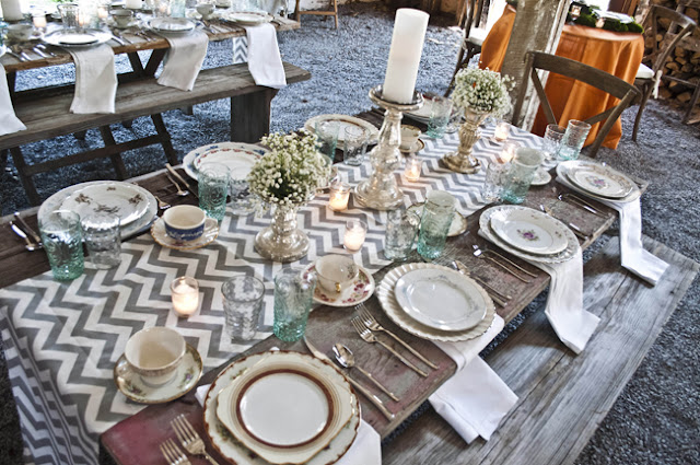 Vintage Rustic Farm Wedding Catskills shot by fine art wedding photographer Angela Cappetta view of room set for dinner in barn long tables