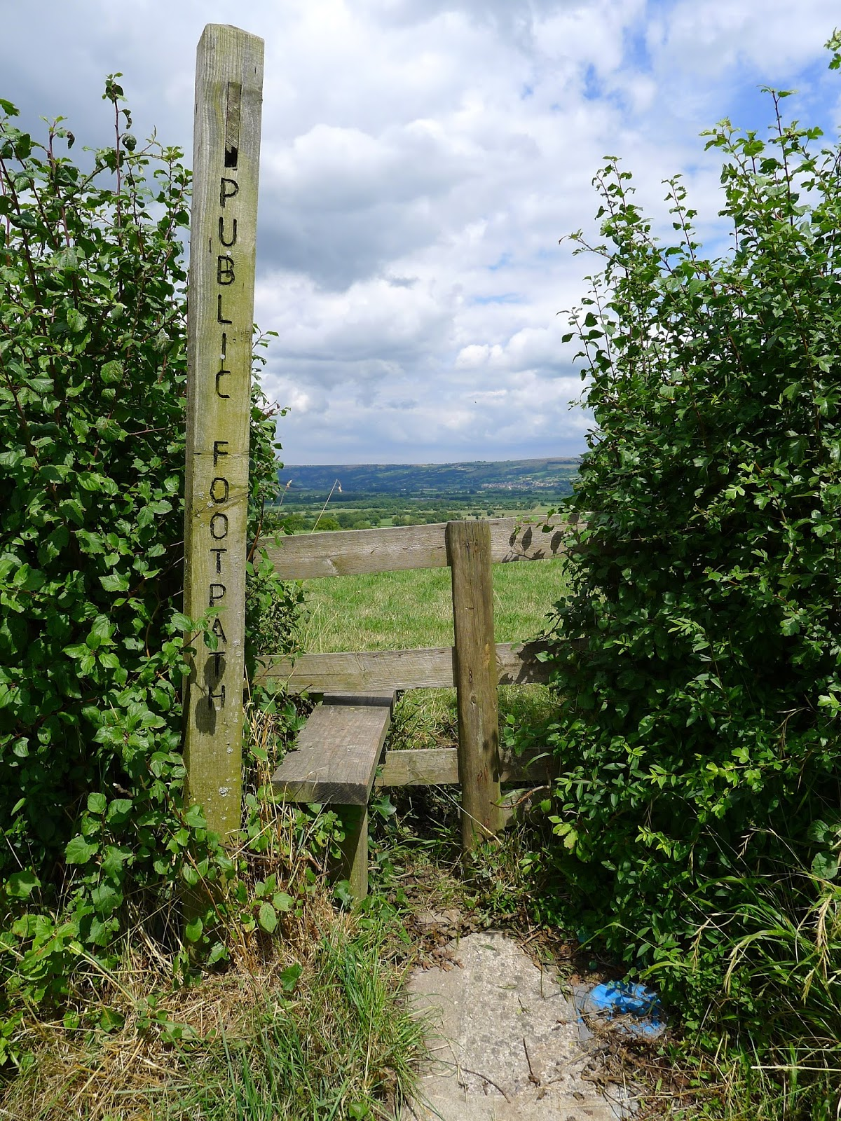 view from somerset cider farm public foot path and fence stile