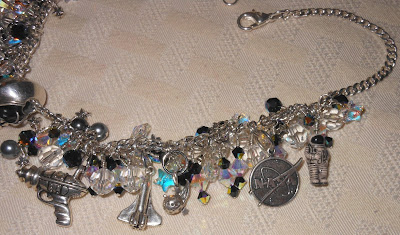 Astronomy necklace, silver alien skull, ray gun, NASA and space charms