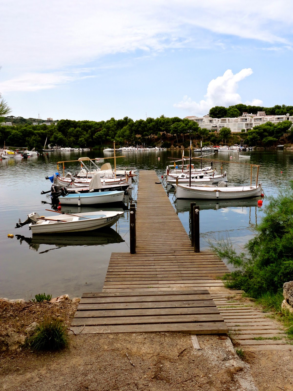 Travel Inspiration | Menorca, Spain | wooden jetty with small boats in harbour