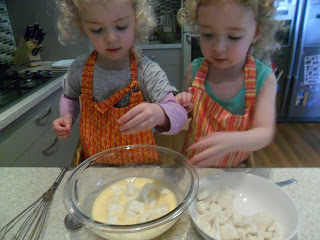 Adding bread cubes to egg mixture for french toast kebabs