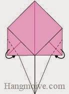 Bước 4: Gấp hai góc giấy về phía mặt sau.