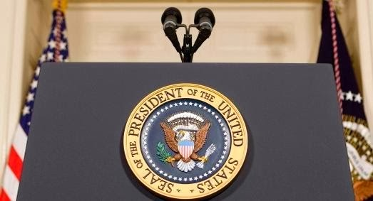 Presidential podium with two microphones and the Presidential seal