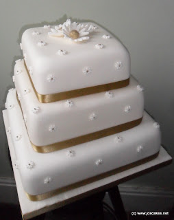 3 tier gold daisy wedding cake