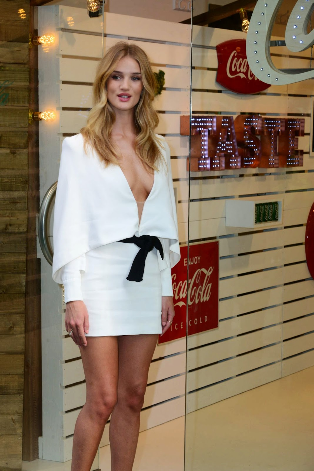 Rosie Huntington-Whiteley shows off cleavage and long legs at the Coca-Cola Life Event in London