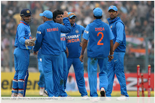 Ravindra-Jadeja-celebrates-Mohammad-Hafeez-Wicket-INDIA-v-PAKISTAN-2nd-ODI-2012