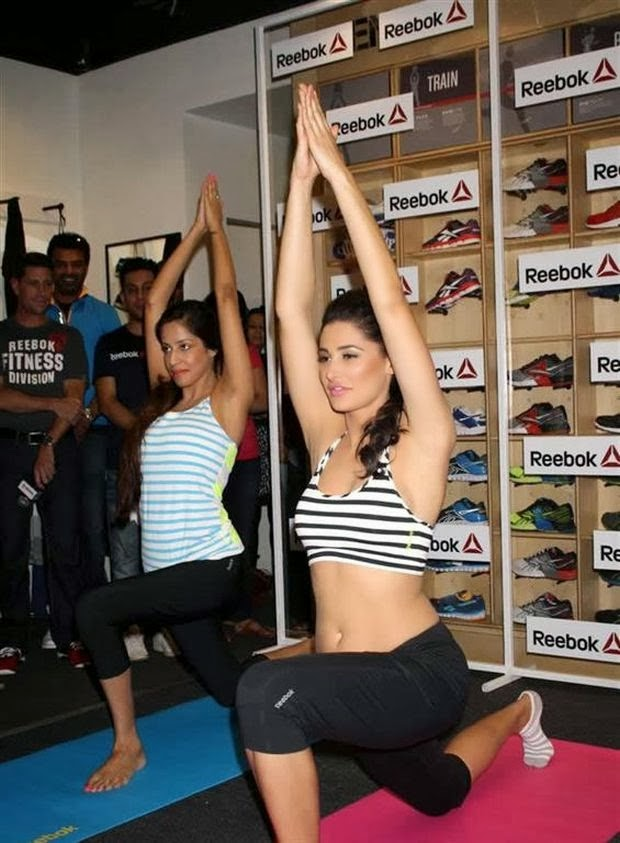 Nargis Fahkri In her black tight leagins doing yoga exercise in reebok ads hot sexy figure thighs kickass exposed