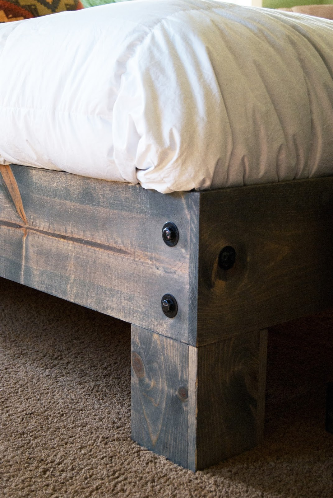 close up of platform bed leg with bolts