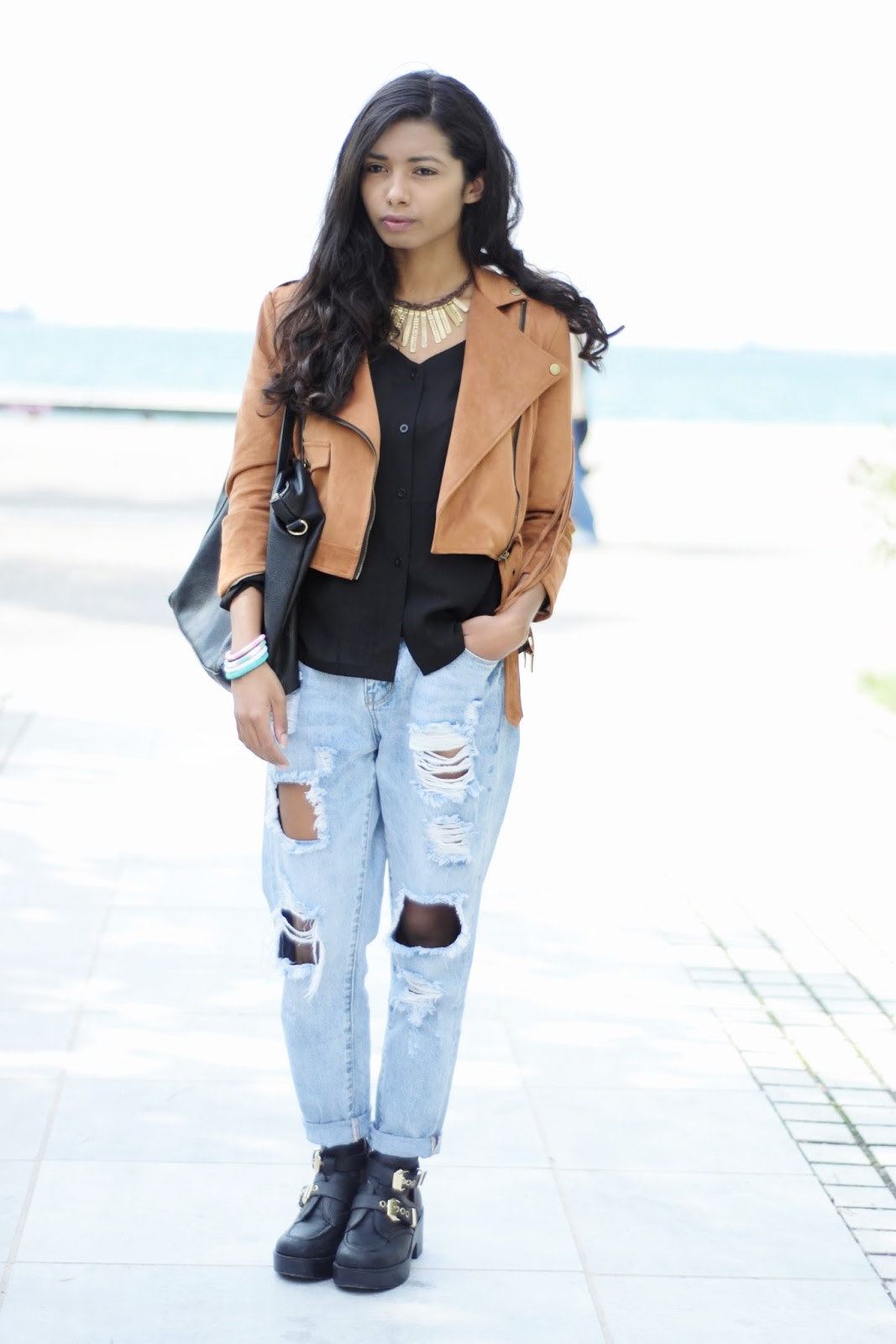 k meets style fringe jacket and distressed jeans