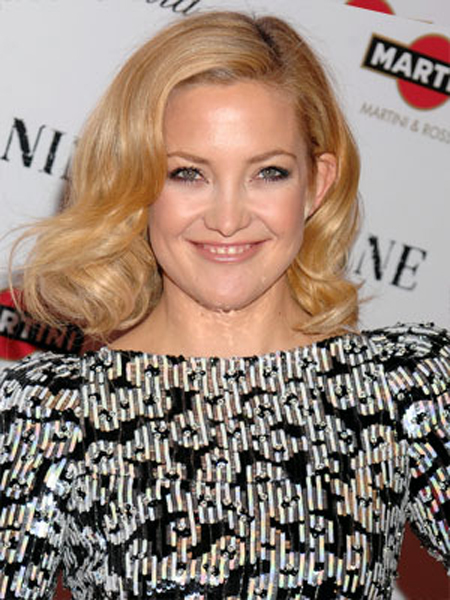 Kate Hudson looks chic and sophisticated with her polished, volumized hairstyle.