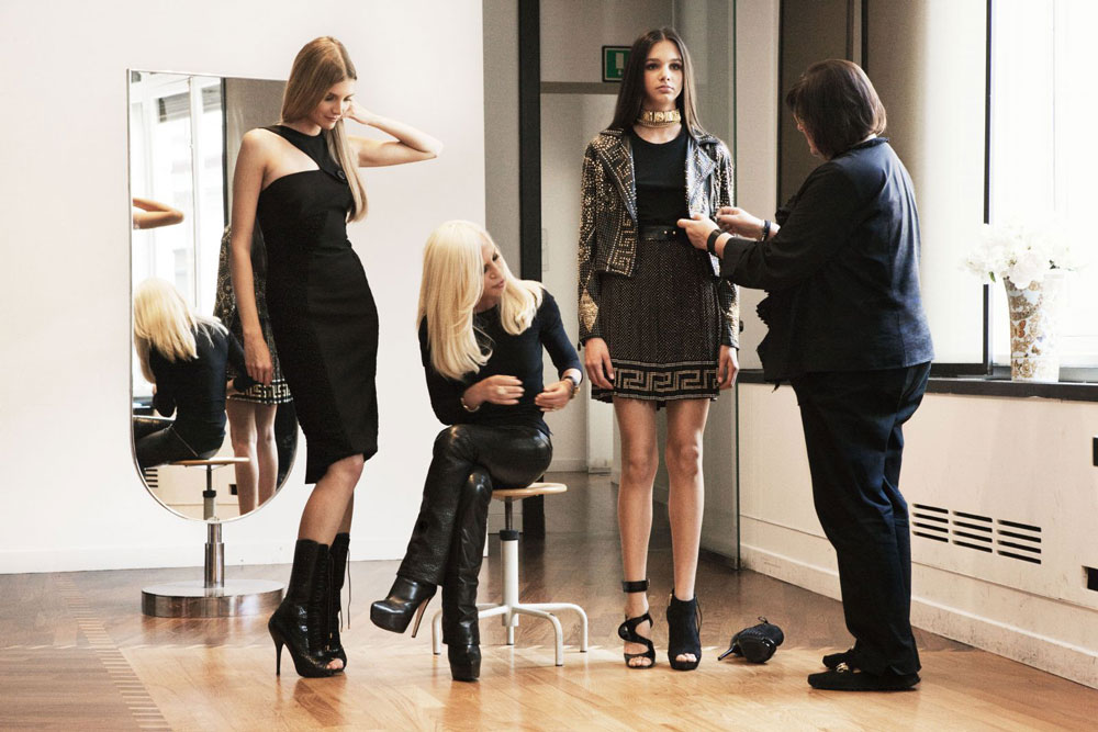 Donatella Versace working on her Versace+H&M collection