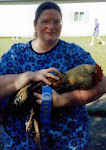 This is me and my blue ribbon rooster- Howard