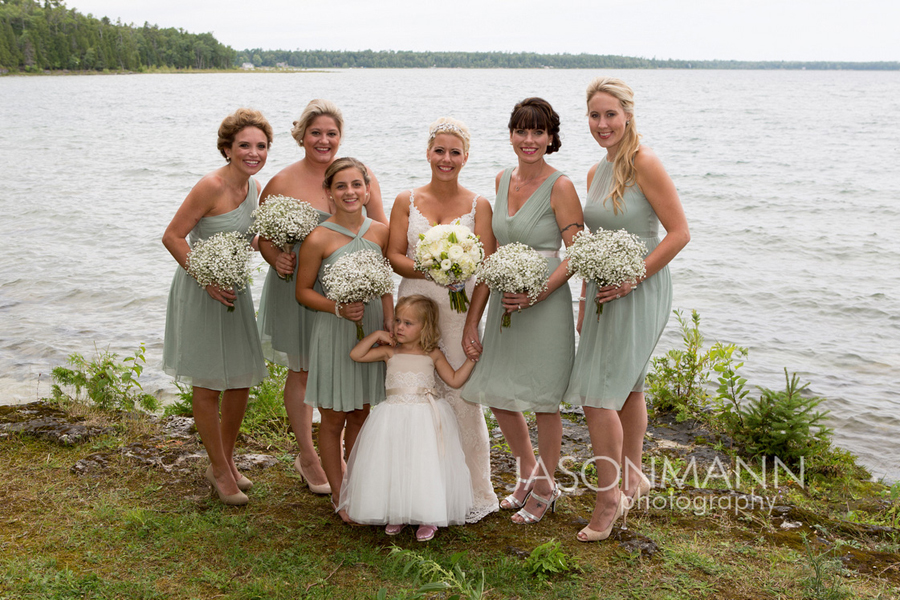 Door County Wedding: Bridesmaids in pastel teal holding babys breath bouquets. Photo by Jason Mann Photography, 920-246-8106, www.jmannphoto.com