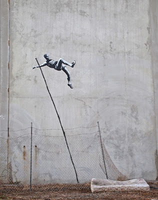 banksy street art olympic pole vaulter mattress spray paint stencil