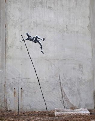 banksy street art olympic pole vaulter mattress spray paint stencil