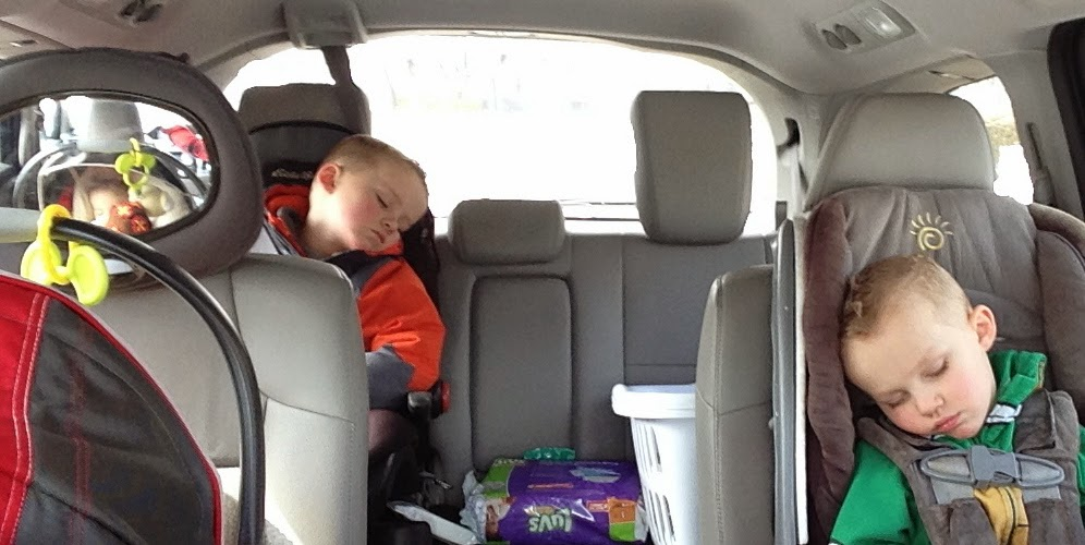 3 kids sleeping in minivan