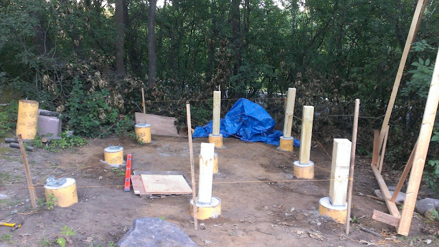 "Posts were cut to the level string plus 9.25"" for the beam height."