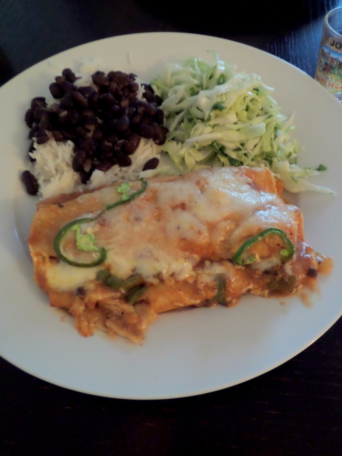 Chicken Enchiladas:  Corn tortillas rolled with chicken and cheese then smothered and baked in a chili sauce.