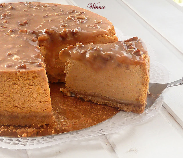 "alt=""Pumpkin cheesecake with caramel pecan glaze"""