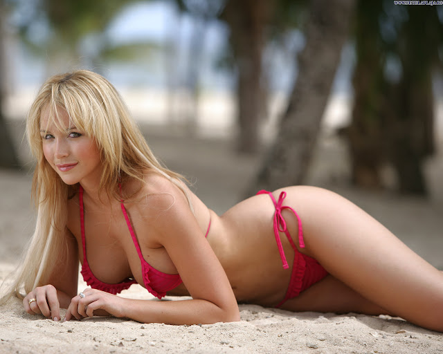 Blonde Beauty with Bikini Lying on the Beach
