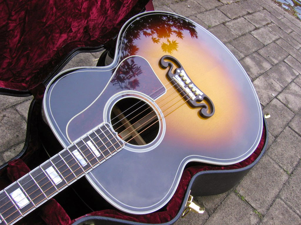 http://hobbyusba.com/gibson-acoustic-guitars-wallpaper-2/
