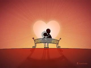 pareja sentada en banca viendo el atardecer