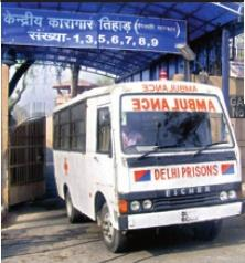 An ambulance comes out of the Tihar Jail in New Delhi